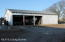 Workshop and Large Equipment shed. Will hold your horse trailer and much more!
