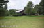 Large yard with old horse barn in good shape