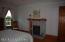 Second floor guest room, original tiled fireplace