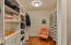 His and Her closet space equipped with laundry chute.