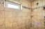 Tiled walk-in shower with window