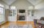 Vaulted ceiling and triple windows keep the space sunny and bright with stunning views of the private backyard