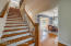 Two staircases lead to the second level of the home. One staircase is wider than the other, making it perfect for carrying furniture