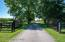 Tree lined drive to property