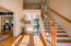 As you enter the home you are welcomed by solid oak flooring