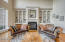 The fireplace (gas/wood burning) is a dramatic focal point for this distinguished space and is framed by built-ins