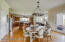 Dining space off of the Kitchen hosts an updated light fixture and updated sliding glass door