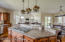 The Kitchen is well lit with multiple windows, plus recessed lighting