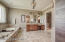 The master bath features tile flooring, separate water closet, dual vanities with granite counters, large jetted soaking tub, and a separate walk-in shower