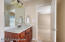 The en suite full bath hosts a tub/shower combination and vanity with stone countertop