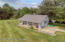 Features a 24' X 40' detached barn- The barn is heated, has a large workshop with benches, space/protection for up to 4 additional cars, additional overhead space for storage, and a large permanently installed air compressor!