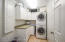 Owner's suite boasts a convenient separate laundry room with plenty of cabinet space
