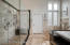 Huge mosaic tiled walk-in shower is absolutely stunning