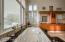 The luxurious en suite bathroom features loads of modern updates