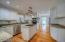 The Kitchen is well lit with recessed lighting and an overhead fixture above the island