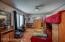 Large first bedroom boasts hardwood floors, and large windows