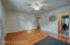 The second bedroom offers hardwood floors, fresh paint and a beautiful ceiling fan