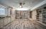 Basement features another separate large room with custom shelving and cabinet space- an incredibly spacious flex area for any and all of your projects!