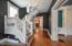 An exquisite chandelier catches your eye when you walk in the front door