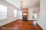Solid dark hardwood floors continue into the dining room