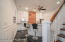 Kitchen is well lit and features recessed lighting as well as a ceiling fan with lights