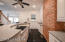 Modern appliances along with the exposed brick maintain the classic Highlands charm