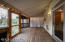 Step out of the kitchen onto the massive screened-in back porch, perfect for relaxing with the family or entertaining your friends