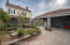 The open garage and patio area provide even more private outdoor spaces perfect for entertaining