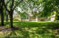 Enjoy a flat, partially shaded yard with mature trees.
