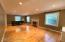 This room is so big it would make great space for a music room!