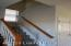 Open stairway leading to 2nd floor. Nice size window on the landing for natural light and airflow on those beautiful Spring Days!