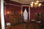 Dining Roomwith picture rail, stained wood work, 6 bulb chandlier & oak flooring,
