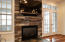slate and stone gas fireplace including flat screen TV