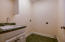 large laundry room with sink off master