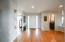 As you enter the home into the foyer, you are welcomed by gorgeous 2 and a quarter inch hardwood oak flooring