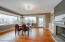 There is absolutely no shortage of natural light in this home- massive windows on 2 full walls offer spectacular views of the large yard and intermittent views of the lake