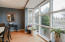 An amazing, 15 paneled, floor to ceiling window brightens up the space