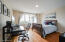 Each of the 3 bedrooms are outfitted with multiple windows, vintage overhead lighting, and hardwood floors