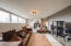 The lower level contains stained concrete floors, multiple windows overlooking the back yard and walk out access to the 4th lower level garage bay