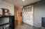 A breath-taking sliding vintage barn door from an Indiana Dairy Farm leads you into the theatre room