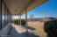 A sprawling covered rear porch is a great place to enjoy the views with a cup of coffee in the morning or a glass of wine in the evening