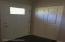 Front door and living room coat closet