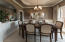 Formal dining room with try ceiling and molding.