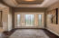 Glass entry-door with sidelights. Foyer includes tray ceiling with crown molding.