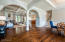 Peeks of the coffered ceiling in Great room. And wall-of-sliders.