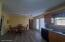 Kitchen has patio doors that lead out to the deck. Hallway in corner leads to laundry and garage