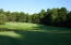 Looking at the 13 the green of the Magnolia Course at Pinewild CC with 16 Perth Place to the right.