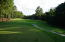 Looking at the 14th hole of the Magnolia Course at Pinewild with 16 Perth Place to the right.