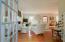 Living room with 10 foot ceilings. Rare pumpkin pine floors.