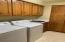Large laundry room with sink and storage
